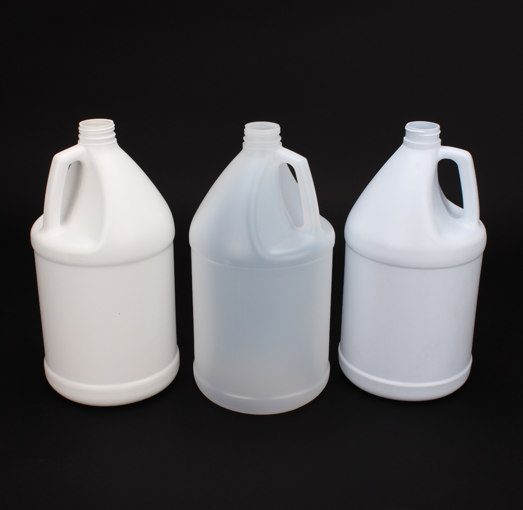 8 Plastic clear and white Gallons #215